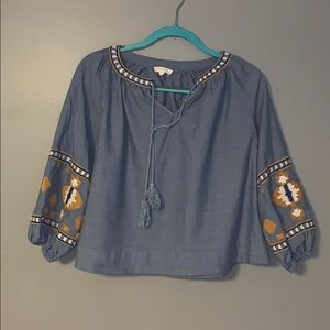 Blue quarter sleeved top with neutral detailing